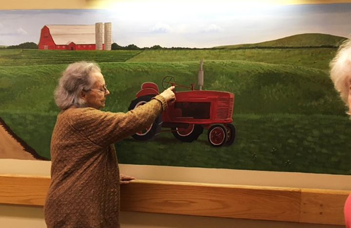 A Memory Care resident reminisces about a tractor they also once had