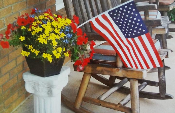 A patriotic scene on the porch of an apartment