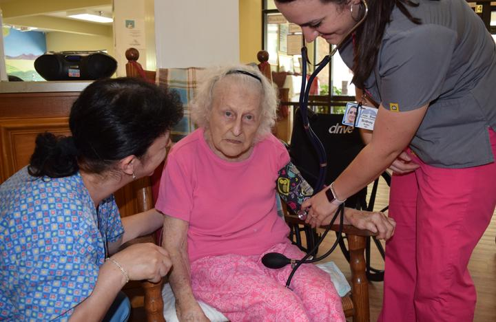 A resident gets her blood pressure checked