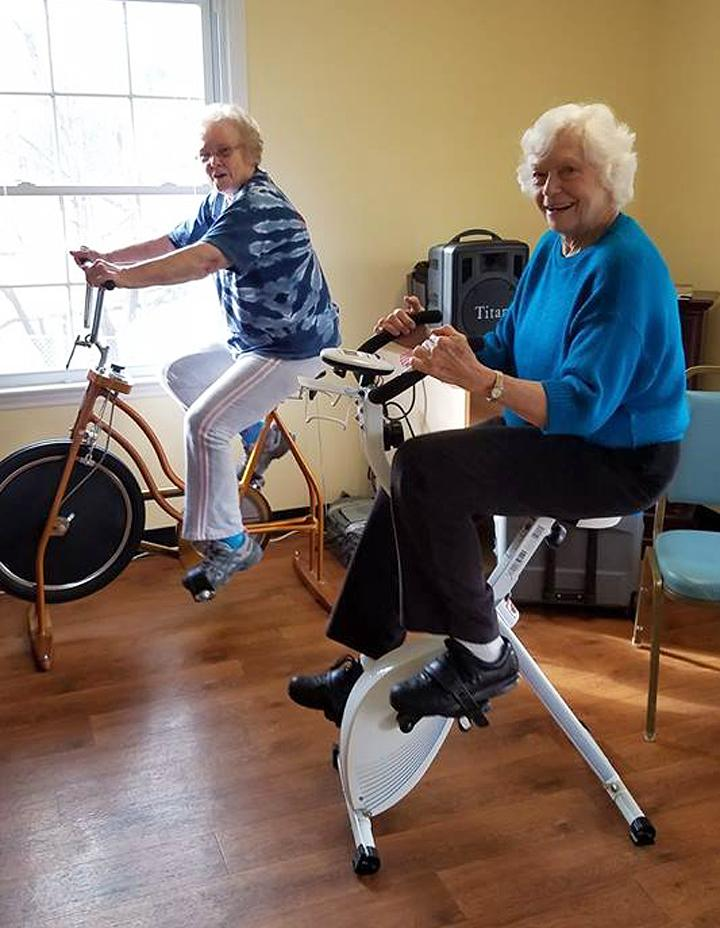 Residents enjoy some exercise on the stationary bikes