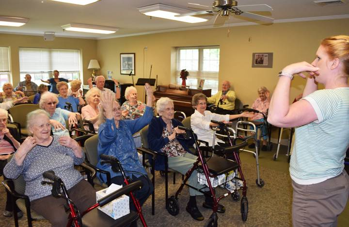 Residents take part in an exercise class with the Activities Director