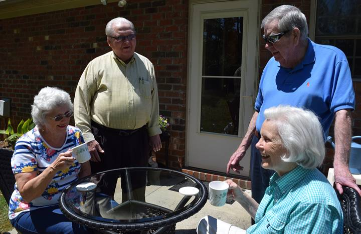 Some Independent Living residents enjoy some time on their outdoor patio
