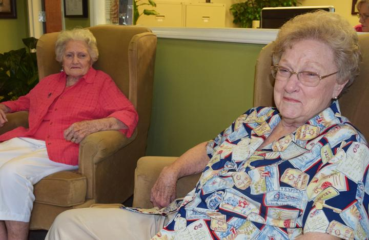 Two of our Assisting Living residents, who happen to be sisters, enjoy some time together