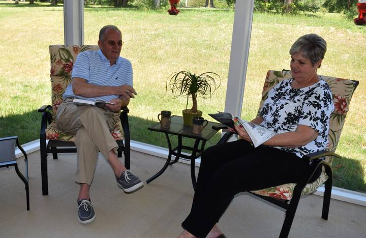 Villa residents enjoy some quiet time on their screened in patio